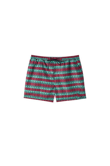 Red green print swimming trunks