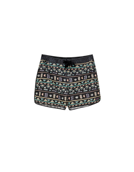 Swimming trunks with multicoloured surfer print