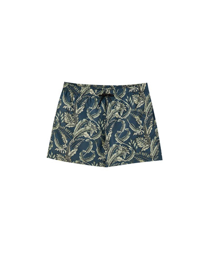 Swimming trunks with tropical leaf print