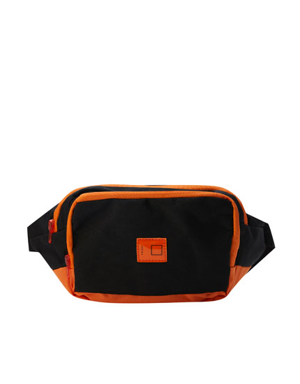 Black belt bag with orange rib detail
