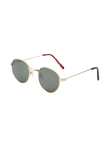 Oval sunglasses with metal frame