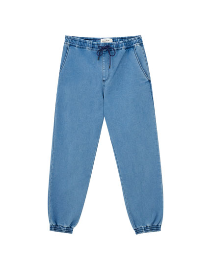 Elasticated denim jogging trousers