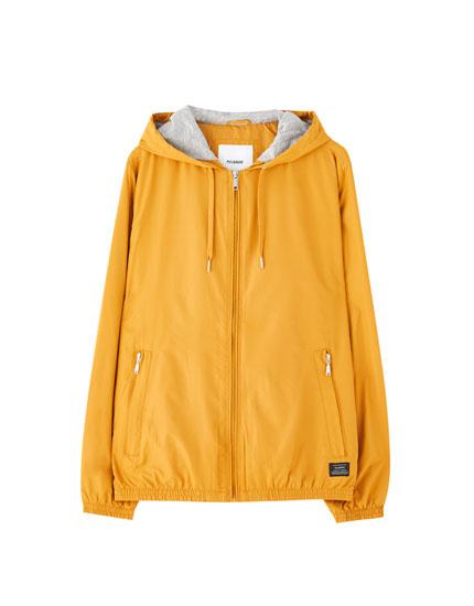 Lightweight jacket with drawstring hood