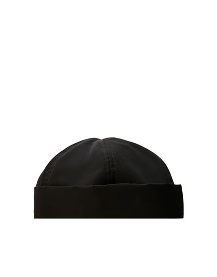 Black hat with rolled-up hem