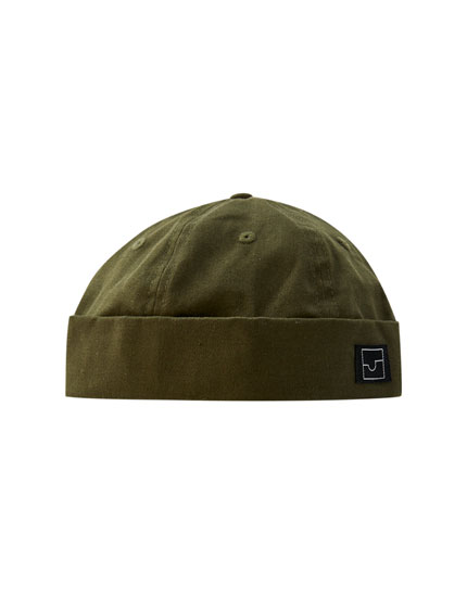Khaki hat with rolled-up hem
