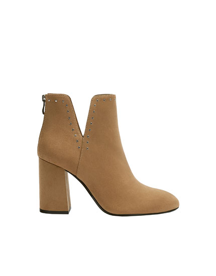 Cut-out camel ankle boots with studs