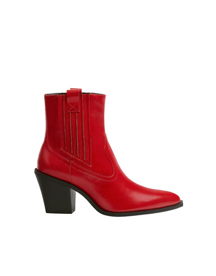 Red cowboy ankle boots with glossy finish