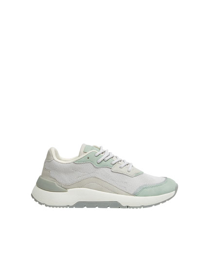 Green trainers with a blend of