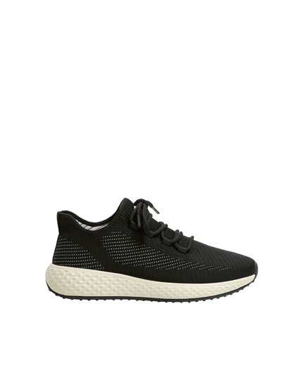 Black stretch trainers