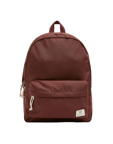 Backpack with contrast zip pull
