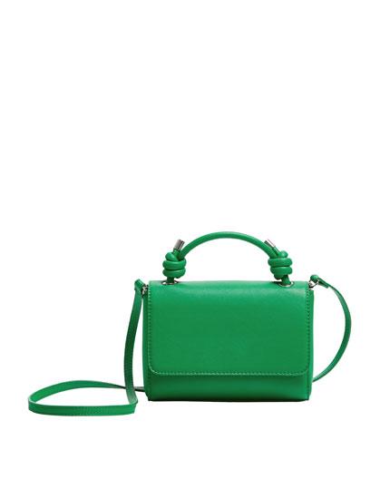 Зеленая сумка с плечевым ремнем и узлами