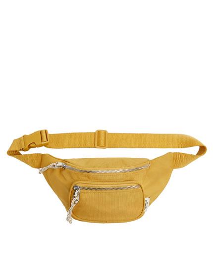 Riñonera amarilla bolsillo