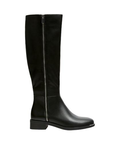 Flat black knee-high boots