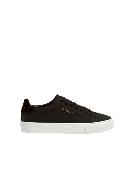 Leather trainers with coordinates detail