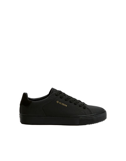 Black coordinates trainers
