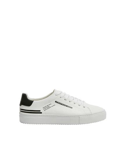 Sneakers scritta