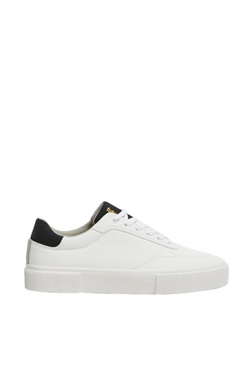 White platform sole trainers