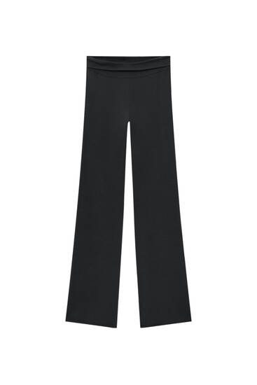 Stretch trousers with fold-over waistband