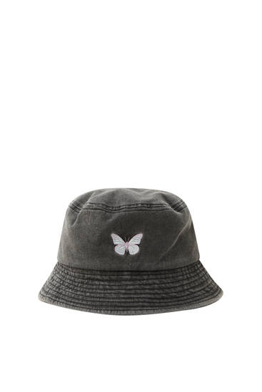 Bucket hat with embroidered butterfly