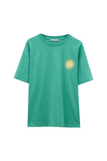 Camiseta verde gráfico