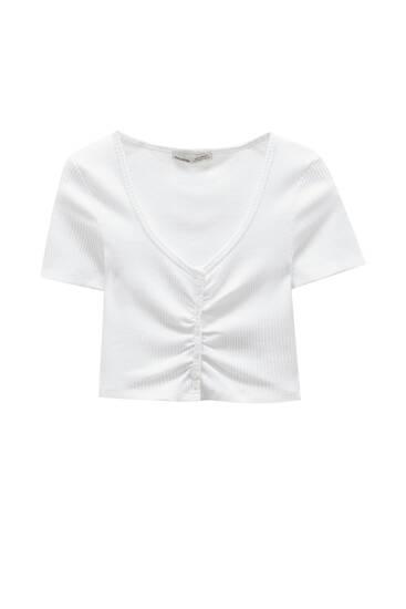 Kort T-shirt i rib med knapper