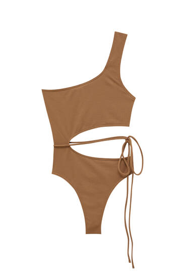 Bodysuit with cut-out and strap detail