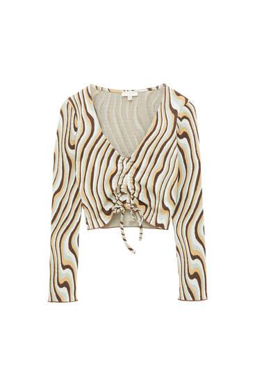 Блуза з хвилястим принтом і довгими рукавами