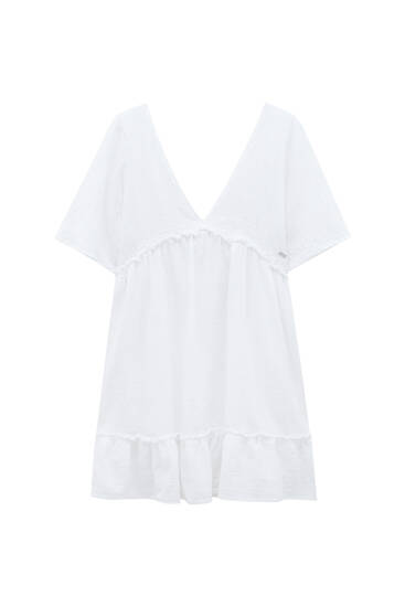 Rustic white dress with ruffles