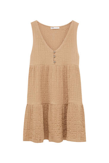 Sleeveless dress made from rustic fabric
