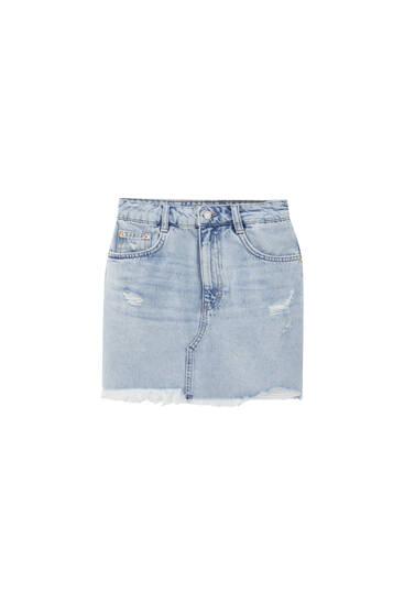 Ripped denim mini skirt