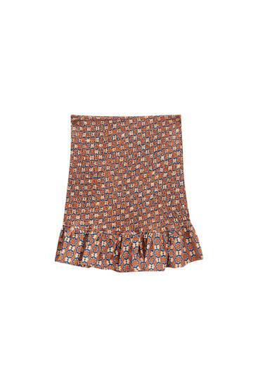 Printed mini skirt with smocking