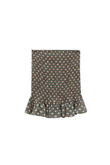 Minifalda estampada goma canilla