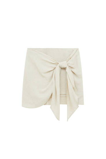 Short wrap skirt with knot