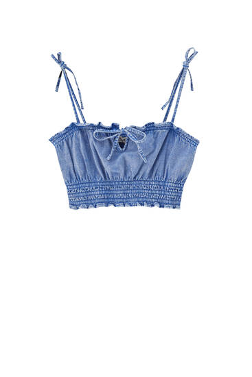 Strappy denim top with ruffle trims