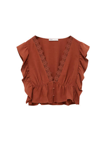 Cropped blouse with lace and ruffles