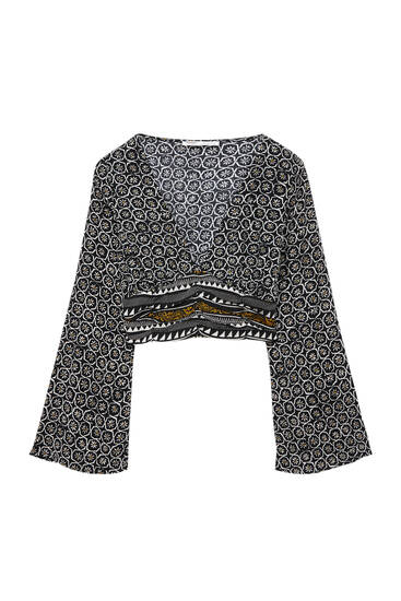 Belled sleeve shirt