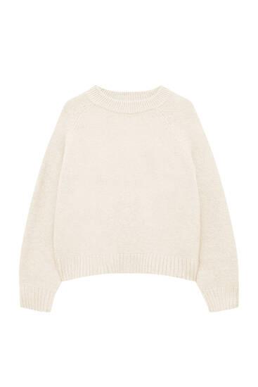 М'який трикотажний светр із розрізами