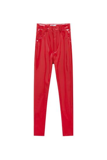Red vinyl skinny trousers