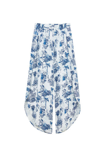 Printed flowing trousers with slits