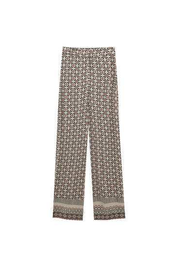 Flowing trousers with border print