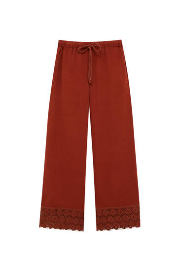 Rustic trousers with crochet detail