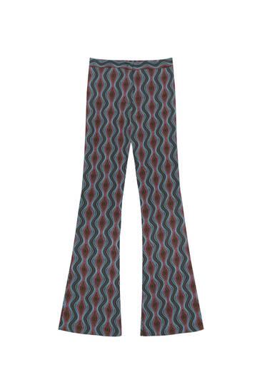 Расклешенные брюки с волнистым принтом