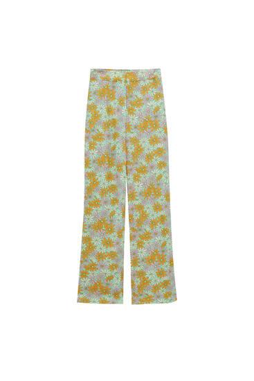 Χυτό παντελόνι με τύπωμα μαργαρίτες