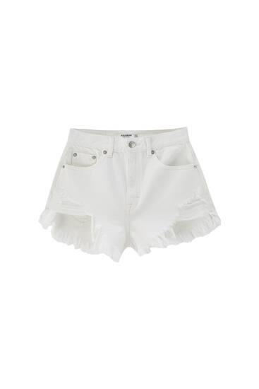 Denim shorts with frayed hems