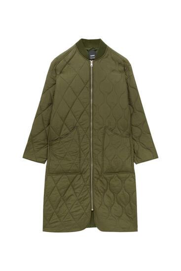 Стеганое пальто с трикотажным воротником