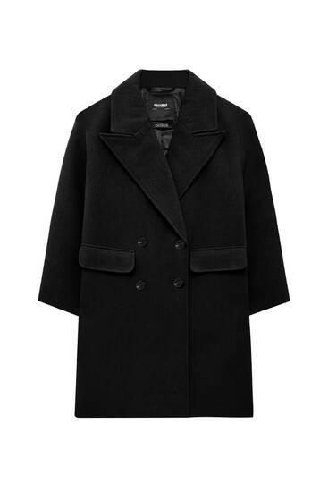 Abrigo largo bolsillos tapeta