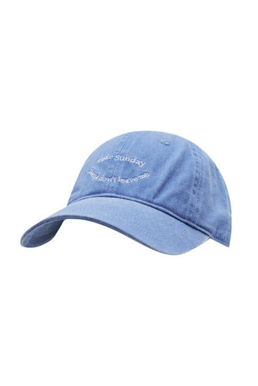 Faded blue cap with embroidery