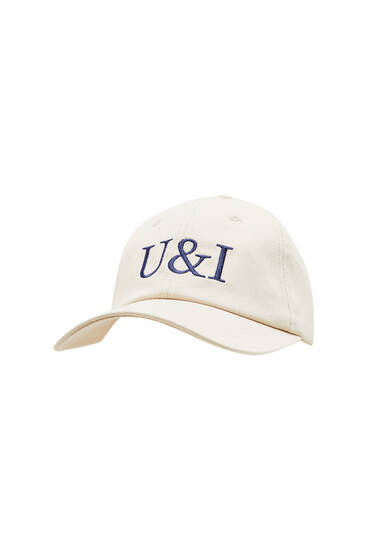 Cap with embroidered acronyms