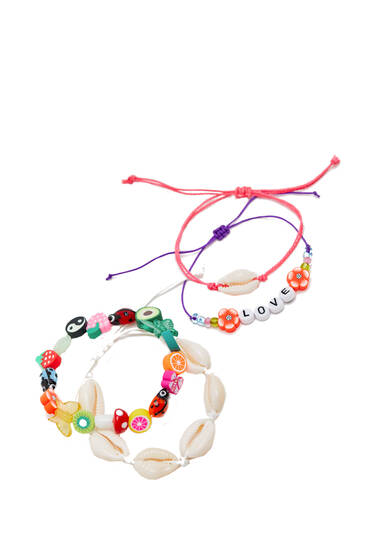 Pack 4 pulseras símbolos abalorios