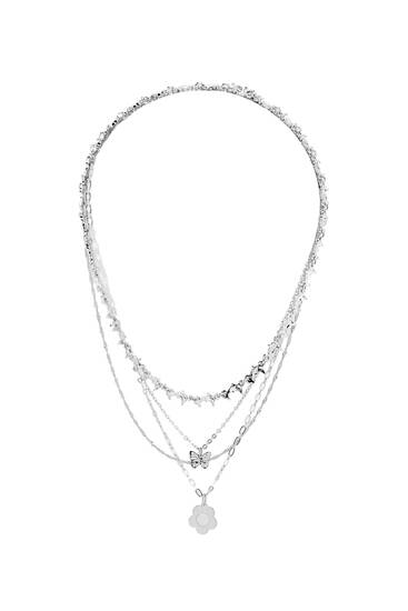 Pack of silver-coloured necklaces with beads